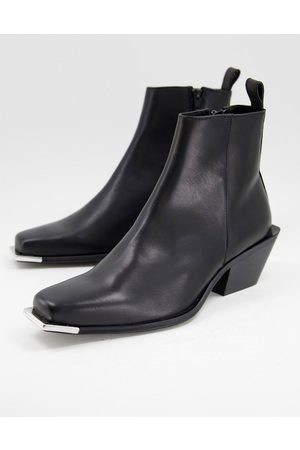 ASOS Cuban heeled chelsea boot in black leather with metal toe detail