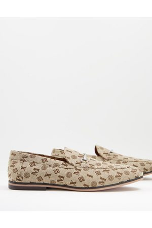 ASOS Loafers in brown monogram print with snaffle