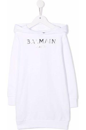 Balmain Niña Estampados - Metallic logo-print hooded jumper dress