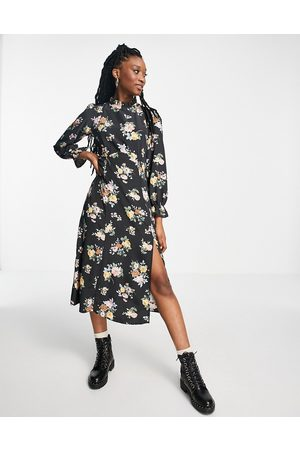 New Look Ruffle neck midi dress in black ditsy floral