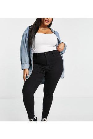 River Island Mujer Skinny - Waxed coated skinny jeans in black