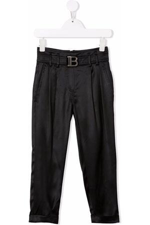Balmain High-waisted logo buckle trousers