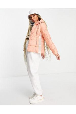 adidas Three stripe slim fit padded jacket in blush