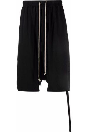 Rick Owens Pantalones vaqueros cortos por la rodilla