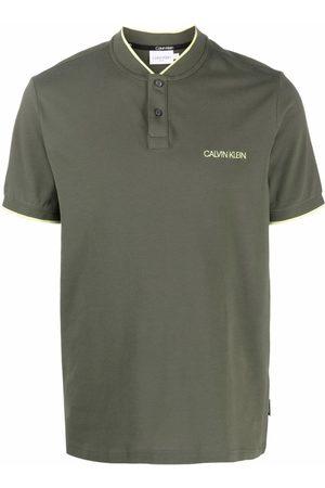 Calvin Klein Hombre Polos - Playera tipo polo sin cuello