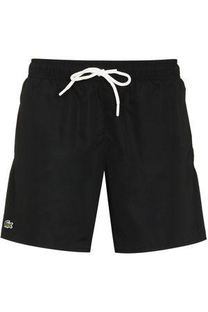 Lacoste Hombre Shorts - Shorts de playa con logo bordado