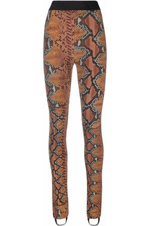 Roberto Cavalli Mujer Leggings y treggings - Leggins con motivo de piel de serpiente