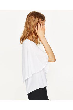 Mujer Camisas y Blusas - Zara CUERPO MANGA ASIMÉTRICO