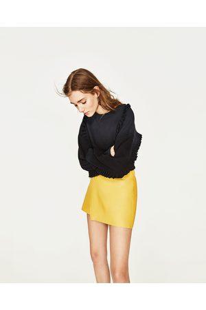 Faldas moda cortas Faldas De Piel de mujer color amarillo ¡Compara ... 3084c936994d